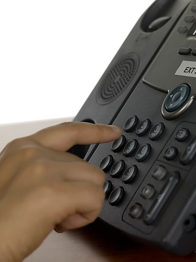 Person dialing phone